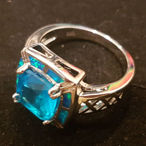 Brand New silver blue topaz & fire opal ring